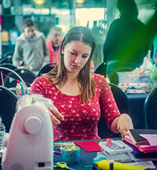 A woman participates in the Maker Festival at Technopolis.
