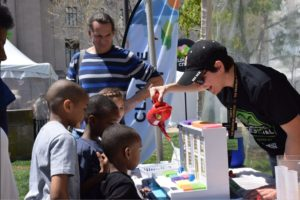 Children watch a science demonstration.