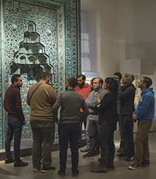 Participants explore the Museum of Islamic Art in Berlin as part of the Multaka: Museum as Meeting Point program.
