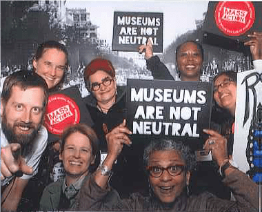 """SMM Statement of Equity and Inclusion authors with """"Museums are not neutral"""" signs"""