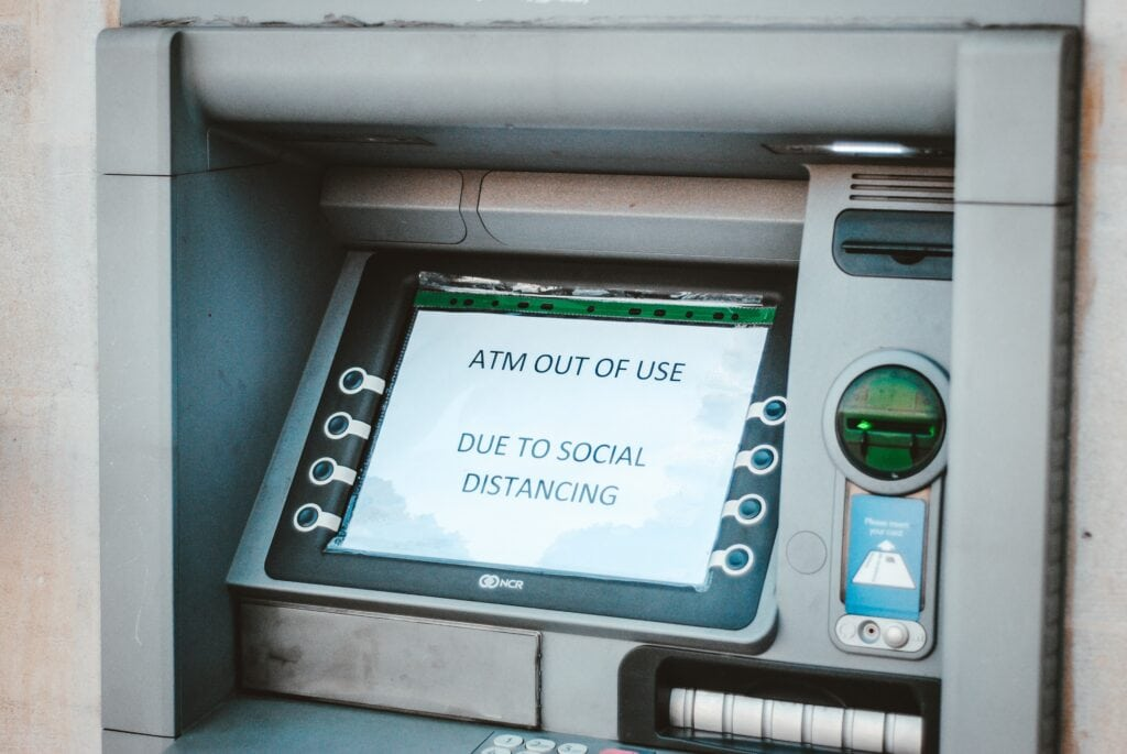 "ATM that says ""ATM out of use due to social distancing"""