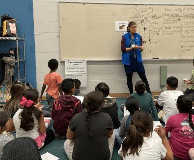 Teacher debriefing students
